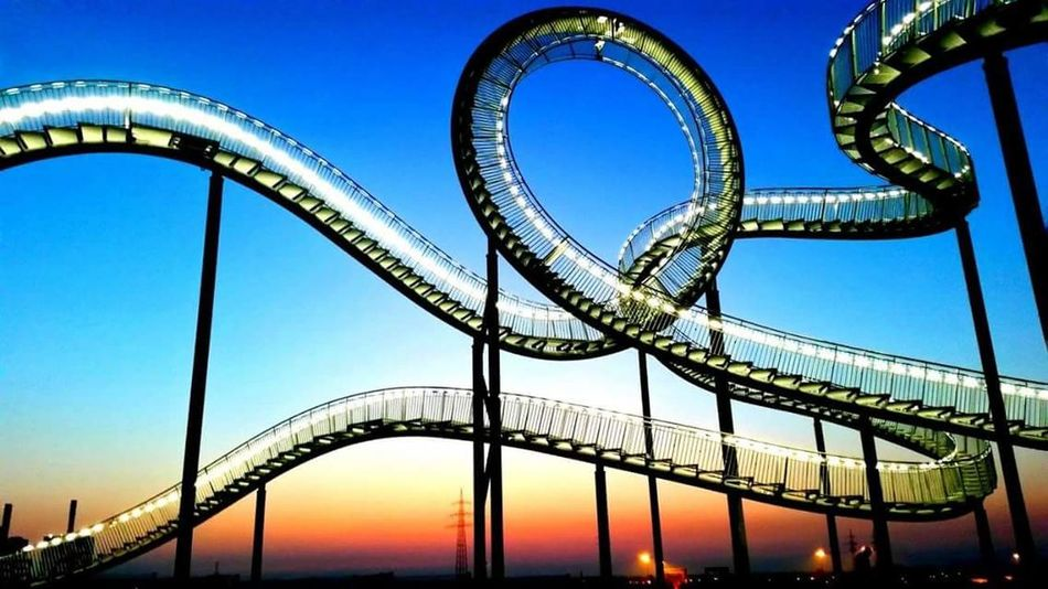 Rollercoaster Bridge - Man Made Structure Arts Culture And Entertainment Blue Sky Travel Destinations No People Night Clear Sky Architecture Tiger And Turtle – Magic Mountain