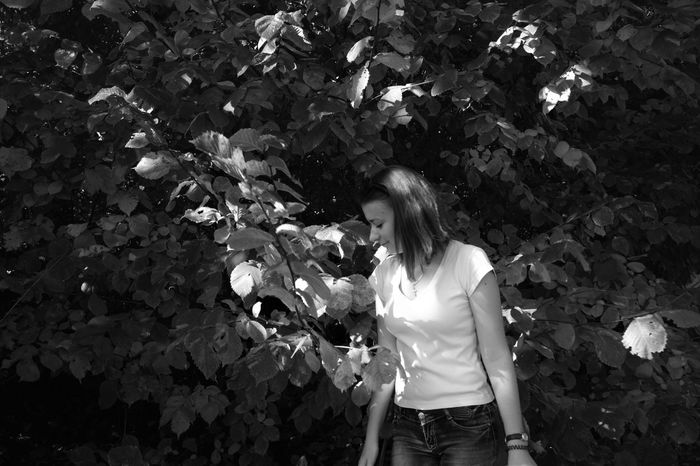 Monochrome Photography Childhood Leaf Elementary Age Girls Standing Flower Growth Freshness Innocence Nature Day Fragility Outdoors Beauty In Nature Green Color Large Magic Beauty In Nature Intresting Place Geometric Shape Beauty Lifestyles Young Women Person