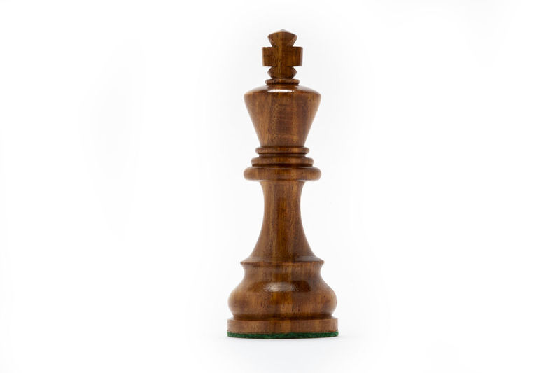 Close-up of chess pieces against white background
