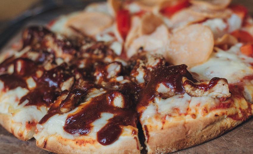 Hot Pizza Slice with Melting Cheese on a rustic wooden table Close-up Day Food Food And Drink Freshness Indoors  No People