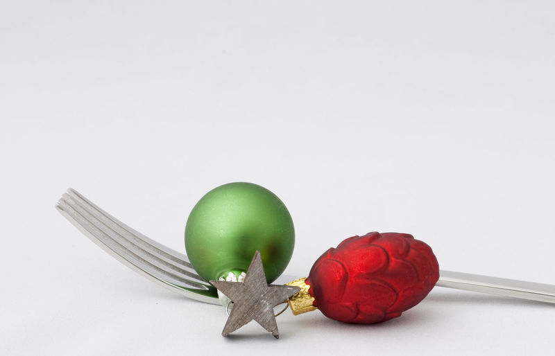 Still Life Indoors  Studio Shot White Background Copy Space Close-up Kitchen Utensil Fork Christmas Christmas Decoration Christmas Ornament Holiday Celebration Merry Christmas! Restaraunt Catering Eating Food And Drink Backgrounds Christmas Decorations Holidays Holiday - Event Star
