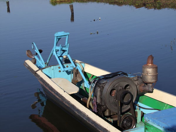 Motor Engine & Propellor on Narrow Boat on Inle Lake Boat Composition Engine Full Frame Health And Safety Inle Lake Lake Mode Of Transport Motor Engine Myanmar Narrow Boat Outdoor Photography Propellor Reflection In The Water Sunlight Traditional Boat Water