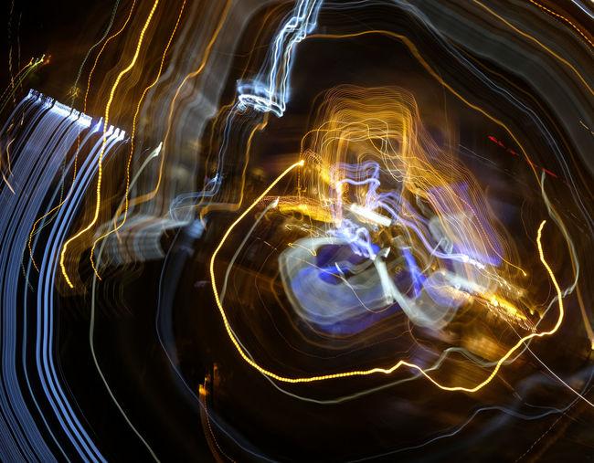 Close-up of illuminated light trails at night