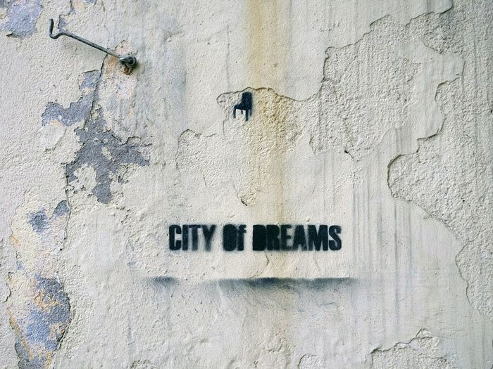 City of Dreams Spray Paint Paint Rebel Graffiti Dreams City Urban Art Street Art Textured  Communication Text Paint Rough Wall - Building Feature Backgrounds Close-up Architecture Built Structure Wall Peeling Off Peeled Weathered Written EyeEmNewHere