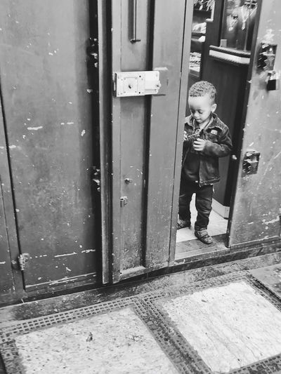 Doors opening in alleyway in Israel—continuation of Israel street photography photos EyeEm Street Photography Awards 2018 Child Full Length Childhood One Person Real People Entrance Door Architecture Boys Innocence