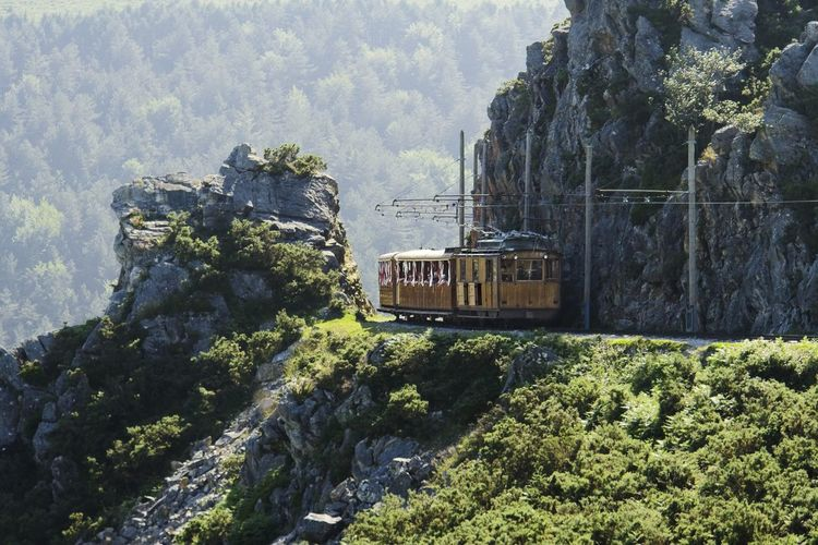 Train passing through rocks