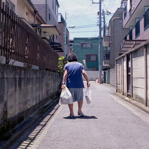 Tokyo Film Photography Film Architecture Full Length City Street Rear View Building Exterior Built Structure Adult Walking Women Real People Casual Clothing Road Lifestyles Bag Day Outdoors Walking Cane Alley EyeEmNewHere