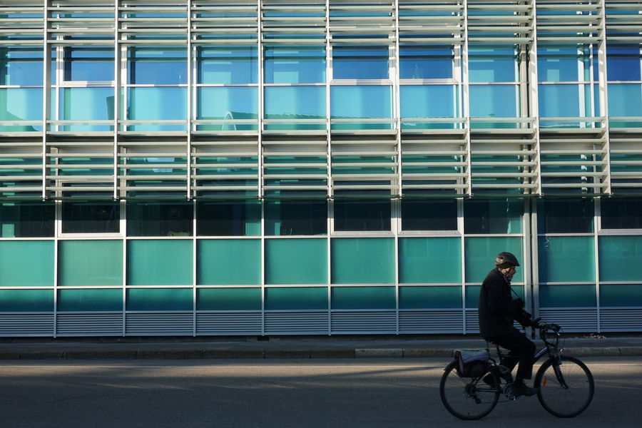 Bicycle Building Building Exterior Ciclyng City Citylife Cityscape Cycling Geometry Hinterland Incidental People Mirrorless No Car Outdoor Outdoor Photography Reflection Slow Life Urban Urbanphotography Window The Week Of Eyeem