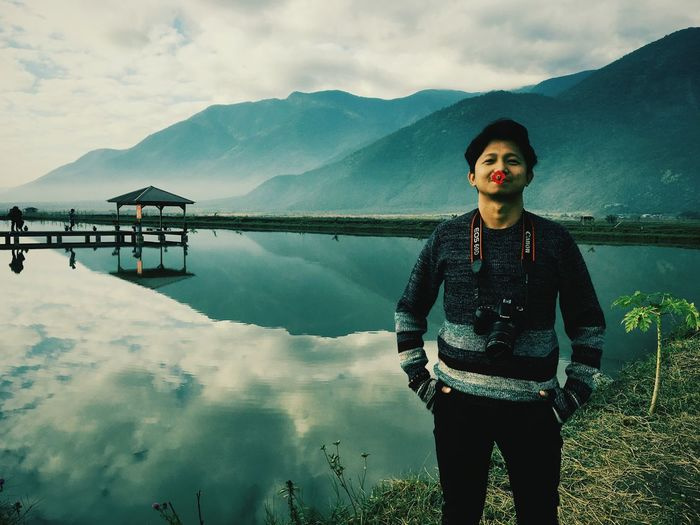 One Person Mountain Water Sky Scenics - Nature Beauty In Nature Lake Nature Standing Adult Mountain Range Landscape Young Adult Cloud - Sky Reflection Tranquil Scene Tranquility Outdoors Contemplation