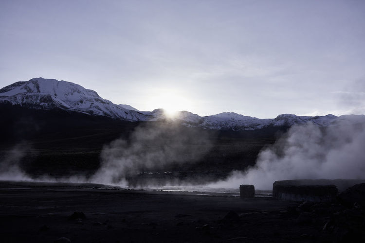 A panorama of the El Tatio geyser field with steam rising in the morning. Atacama Desert Chile El Tatio Panorama Travel Photography Vista Beauty In Nature Geyser Hot Spring Landscape Mountain Mountains No People Physical Geography Scenics South America Steam Sunrise Tranquil Scene Travel Destinations