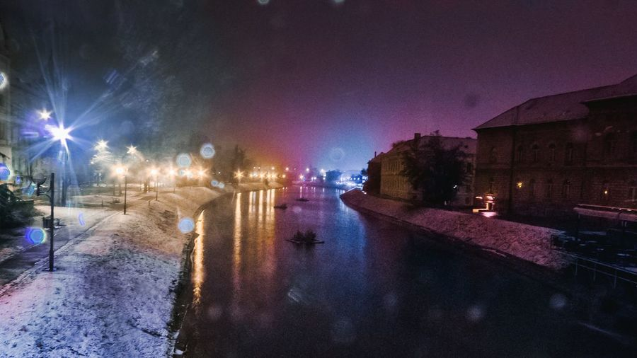 Night Illuminated City Reflection Outdoors Nightlife Water Sky No People Cold Temperature Cityscape Zrenjanin Buildings City Snow Winter Building Exterior Long Exposure Long Exposure Night Photography Long Exposure Water River Begej Zrenjanin Begej River Colorful Night Colors #night