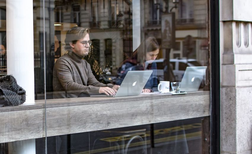 Streetphotography Street Photography Portrait Working Apple Laptop Coffee Turtleneck Glasses Concentration Man Woman Same  Pose Showcase: February