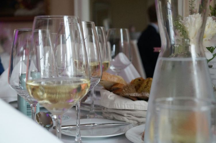 Glasses Vine Glasses White Vine Drink Wedding Photography No People White Tablecloth Napkin Table Setting Table Bread Decoration Wedding White Porcelain Flowers Pastel Colors Cutlery Vase Cold Water Glass Of Water Happy Day Flowers On Table Glasses On The Table Menu Summer Wedding