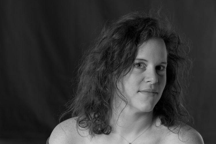 Portrait of woman against backdrop