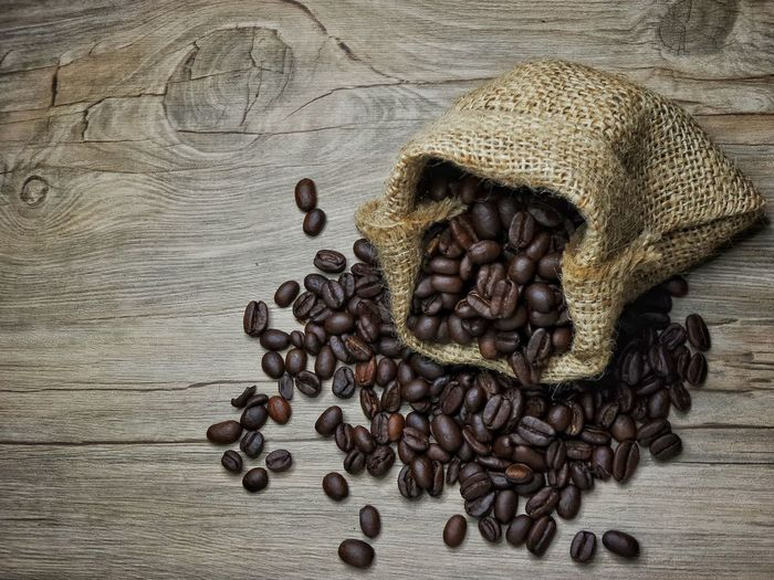coffee seed with cup of coffee and sack texture Brown Close-up Coffee Seeds Cup Of Coffee Day Food Food And Drink Freshness Hot Drink Indoors  No People Sackcloth