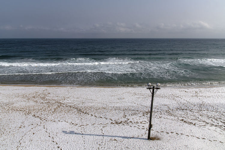 morning beach at Cheonjin in Goseong, Gangwondo, South Korea Cheonjin Beach Day Winter Morning Sea Beach Water Horizon Land Horizon Over Water Sky Scenics - Nature Beauty In Nature Sand Wave Tranquility Tranquil Scene Motion Nature No People Sport Idyllic Outdoors Wooden Post