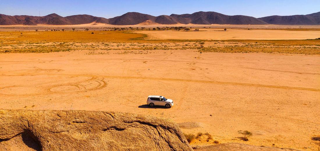View of car on desert land