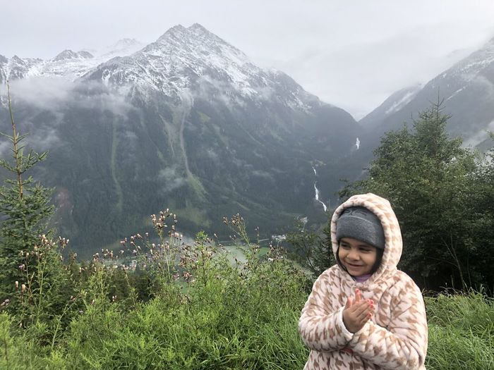 Close-up of girl against mountains