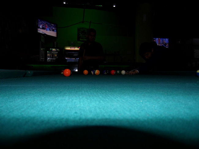 Adult Adults Only Ball Competition Illuminated Indoors  Leisure Activity Leisure Games Lifestyles Men One Man Only One Person Only Men People Playing Pool - Cue Sport Pool Ball Pool Cue Pool Hall Pool Table Rear View Snooker Snooker And Pool Snooker Ball Sport