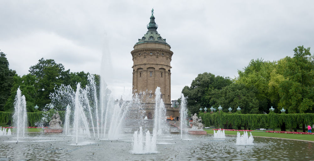 Fountain against mannheim water tower