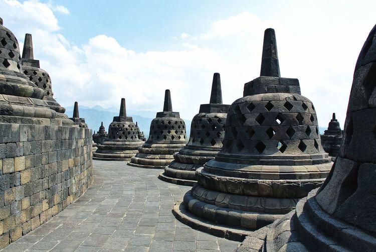 Ancient temple against building