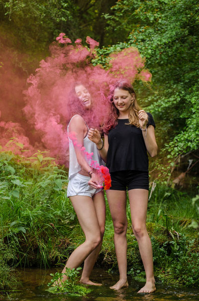 Colours Smoke Art Colorful Contrast Friendship Full Length Girls Holi Holi Gaudy Holi Powder Outdoors Pink Color Powder Paint Pyrotechnics River Smokebombs Togetherness Two People Young Adult Done That.