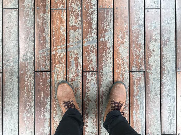 Low section of man on boardwalk