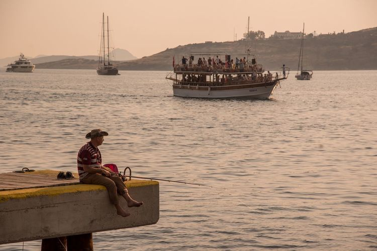 Sunset in Bodrum Water Nautical Vessel Sea Sky Real People One Person Lifestyles Men Leisure Activity Fisherman