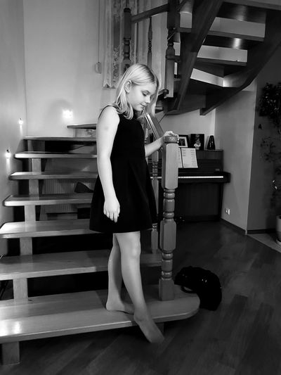 Full length of girl standing on steps at home