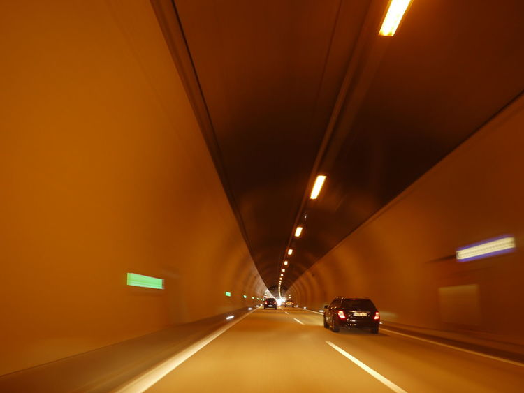 Blurred Motion Car City Headlight Illuminated Land Vehicle Lighting Equipment Mode Of Transport Motion Night No People Outdoors Parking Garage Road Speed Street Light The Way Forward Transportation Tunnel Vehicle Light