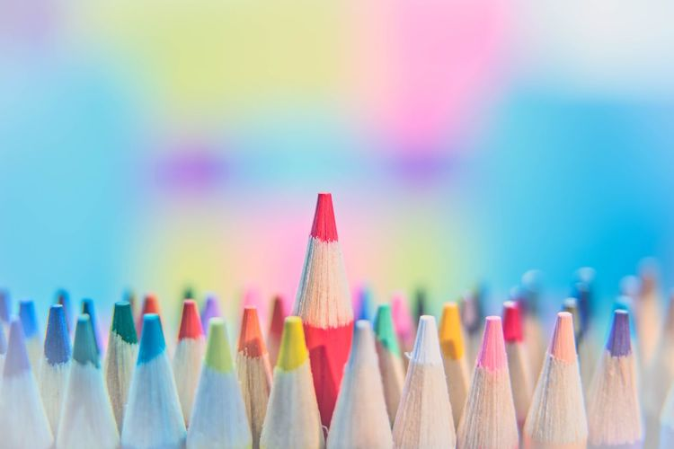 Close-Up Of Abundant Colored Pencils Symbolizing One Standing Out