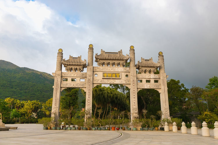 Architecture Sky The Past History Built Structure Nature Travel Destinations Tree Plant Cloud - Sky Building Exterior Day Travel Tourism Arch No People Ancient Architectural Column Memorial Outdoors Ancient Civilization Po Lin Monastery HongKong Buddhism