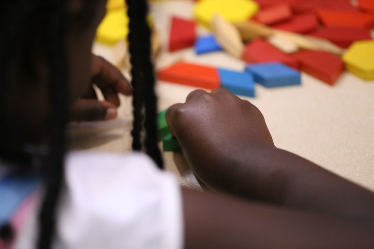 Close-Up Midsection Girl Playing With Toy Blocks On Table