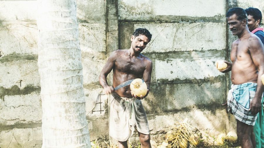 Working man in a coconut farm in kochi, KeralaDepth Of Field Light And Shadow Telling Stories Differently Outdoors Candid Photography Sunny Day My Favorite Photo Exploring Street Photography Tender Coconut Working Man Traditional Culture Farmland Open Edit Kerala Cutting Coconut People Sweating It Out