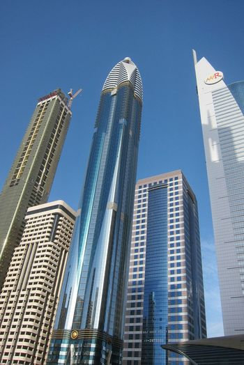 Tomorrowland Skyscrapers Buildings Dubai Buildings And Sky Architecture No People Commercial Building Business District Highrises Built Structure Envision The Future The City Light #urbanana: The Urban Playground