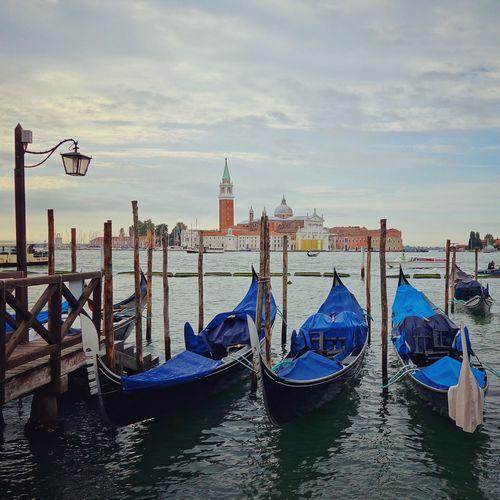 Gondolas on grand canal with church of san giorgio maggiore in background