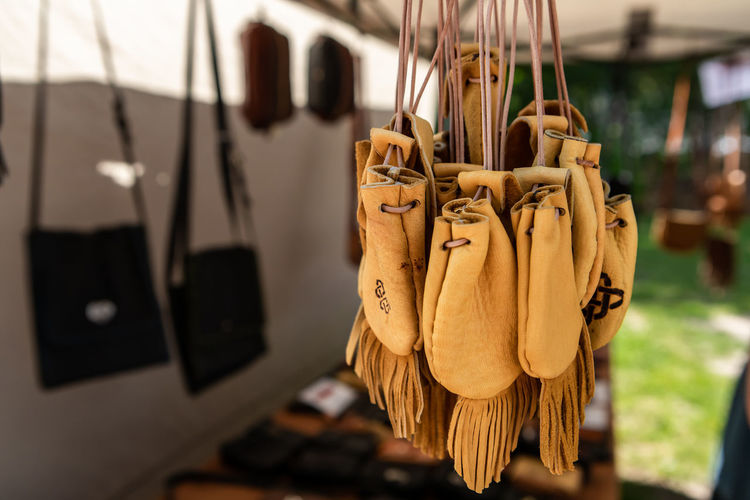 Close-up of clothes hanging on rope at home