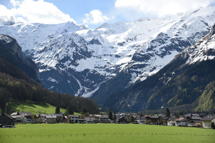 Engelberg Mountain Snow Grass Sky Building Snowcapped Mountain Landscape Beauty In Nature Mountain Range