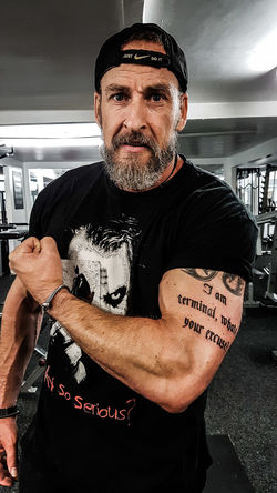 Bearded Bearded Nerd Oaf CancerWarrior Cancer Terminal Portrait Looking At Camera Flexing Muscles Body Building Human Muscle Tattoo Bicep Weightlifting