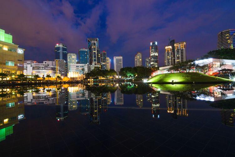 Reflection Of Urban Skyline In Lake