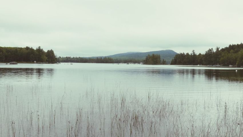 Cloudy Mainewilderness Maine Pond Calm Fresh Water Serene Pond Life Calmwater Clouds And Mountains