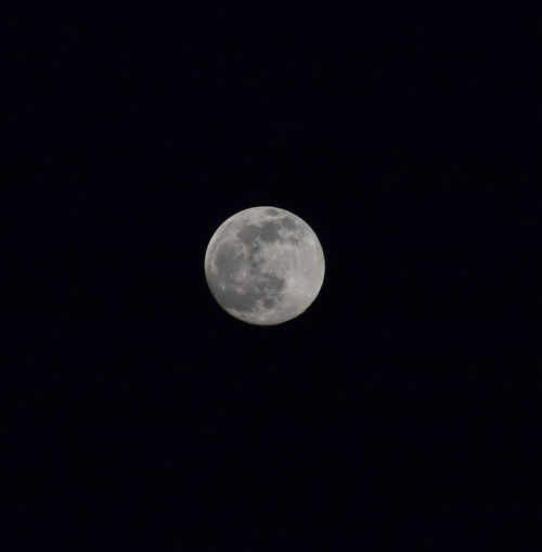 Low angle view of full moon in sky