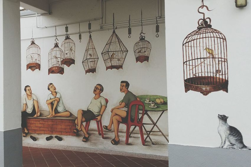 Art Wall Art depicting a group of older men enjoying a Chit Chat Session and the singing of their Birds. Birdcages Hobby Songbirds Tiong Bahru Singapore