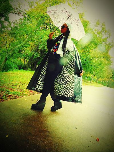 PLCP Clothing Line Raincoat Umbrella Rainy Day Rain Droplets Lens Texas Photography EyeEmNewHere Capture The Moment Texas Pictures Photographer Vibrant Color Photography Nature Photography Texas Skies Scenics Fashion Fashion Photography Women Love Peace Entrepreneur Owner Tranquility Uniqueness