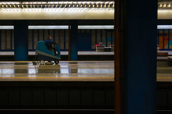 Man going on his wash macine in circles on the platform of Warsaw Central Station. He saw me when I was trying to cature him. He was trying to excape but at some point he had to turn and be immortalized. #sysiphos 365project Built Structure Cleaning Cleaning Man' Dark Mood Day Going Circles Indoors  Men Mundane One Person Only Men Pillars Platform Railstation Sisyphos Slippery Floor Warsaw Washing Cart Wet Floor