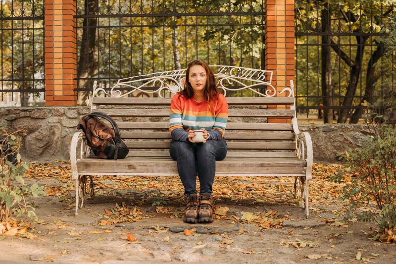 Portrait of girl sitting on bench