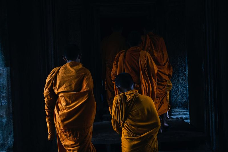 Rear View Of Monks Walking In Temple