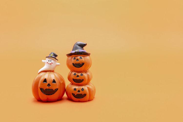 View of illuminated pumpkin against orange background