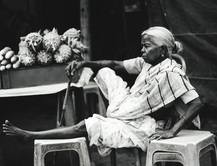 Side view of man sitting on seat
