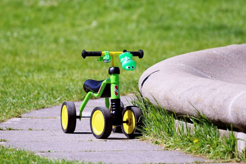 Kids Bike Lost And Found Close-up Day Grass Green Color Mode Of Transportation Nature No People Outdoors Toy Transportation